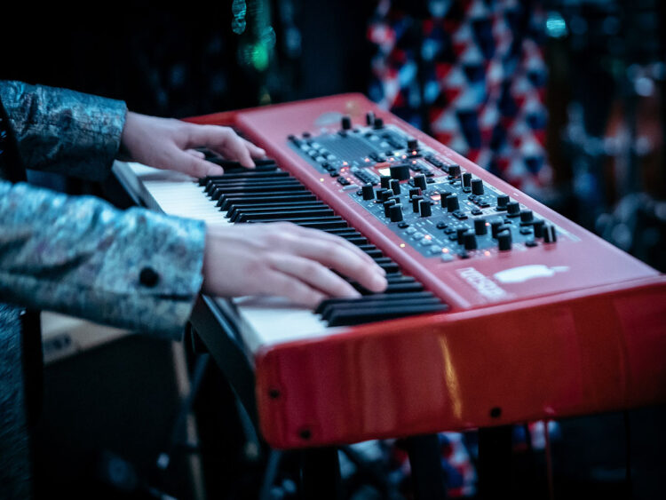 musician playing on a Nord keyboard