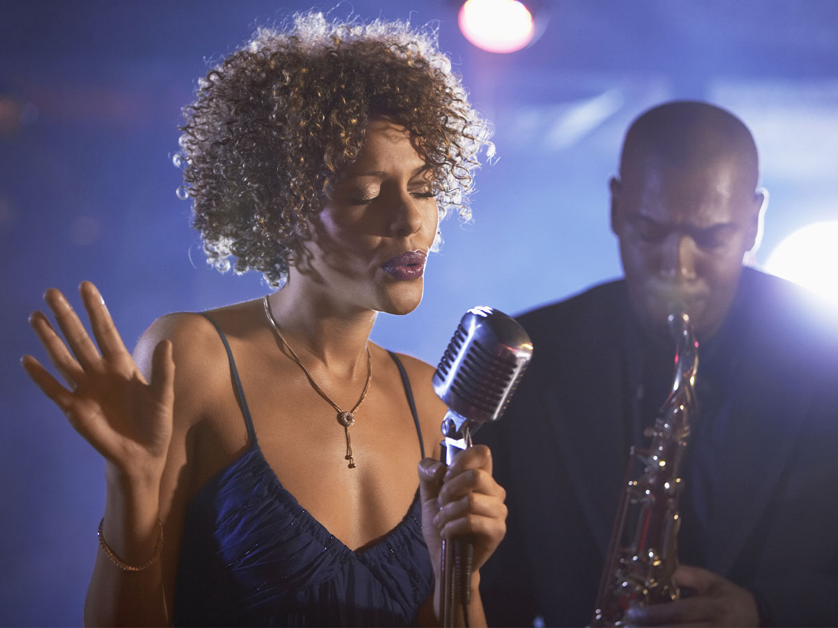 A singer and a saxophone player onstage