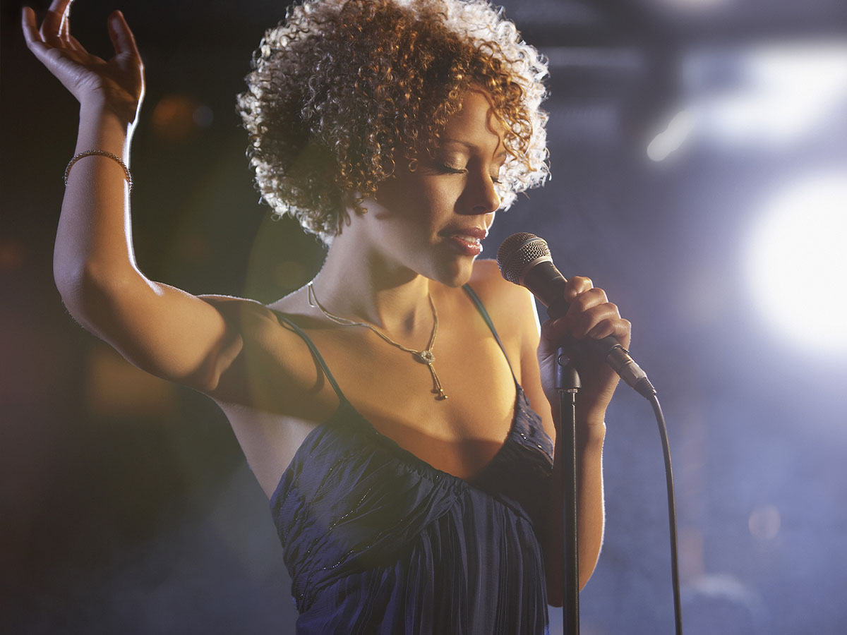 Female singer singing into a microphone